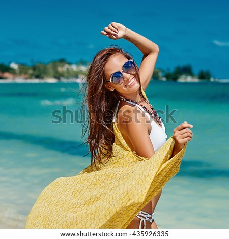 Summer portrait of young pretty woman having fun on a tropical beach - stock photo