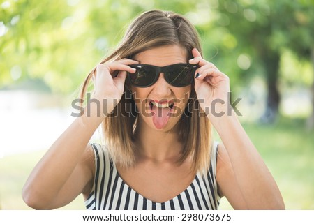 Summer portrait, young brunette woman having fun outdoor - stock photo