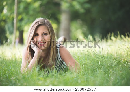 Summer portrait, young brunette woman posing outdoor - stock photo