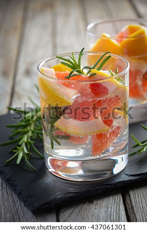 Summer refreshing drink with grapefruit and rosemary, selective focus, copy space - stock photo