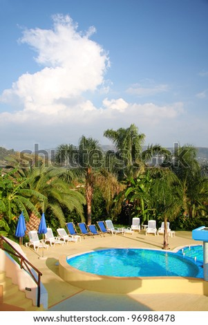 Summer resort with swimming pool - stock photo