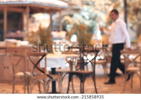 summer restaurant blurred background - stock photo