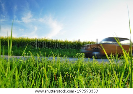 Summer ride, car on the road heading for a holiday - stock photo