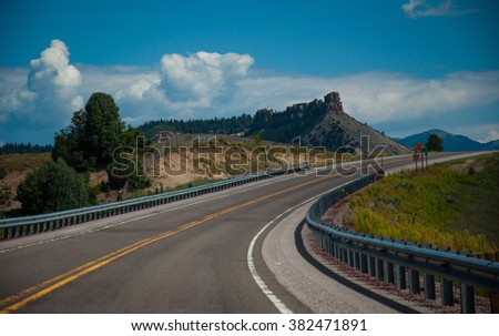 Summer road trip Through the Southwest America Colorado Landscape Driving on the highway Jagged Peaks in the background near Durango and Silverton on a curved Road