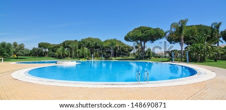 Summer-round outdoor swimming pool. In the hotel to rest. - stock photo