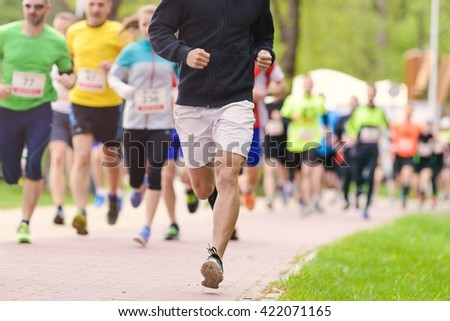 Summer running race in the park, people running