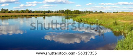Summer rushy lake panorama view with clouds reflections. Six shots composite picture. - stock photo