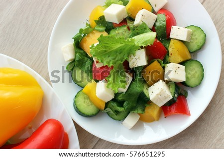 Summer salad of peppers, lettuce and slices of cheese.