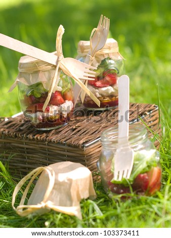 Summer salad with strawberry in glass bank for picnic, selective focus - stock photo