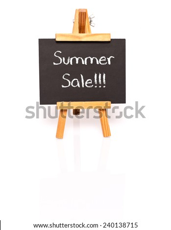 Summer Sale. Blackboard with text and easel. Photo on white background with shadow and reflection. - stock photo