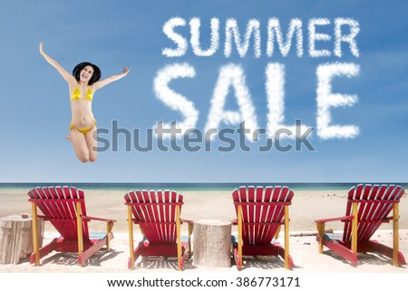 Summer sale clouds with sexy woman jumping over beach chairs - stock photo