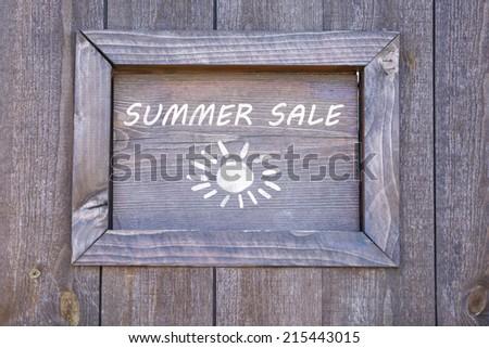 Summer sale written on wooden frame, close-up - stock photo