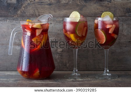 Summer sangria on a rustic wood  - stock photo