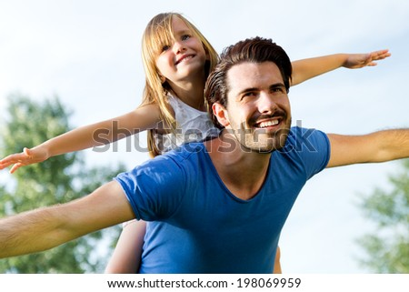Summer scene of father and Daughter having fun outdoors - stock photo