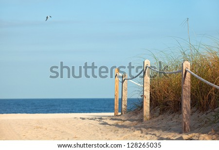 Summer scene, Pathway to the beach in Miami Beach Florida with ocean and blue sky background - stock photo