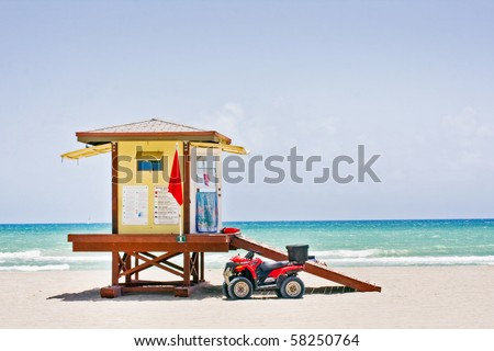 Summer scene with a  colorful lifeguard house in Hollywood Beach, Florida with blue sky and ocean in the background - stock photo