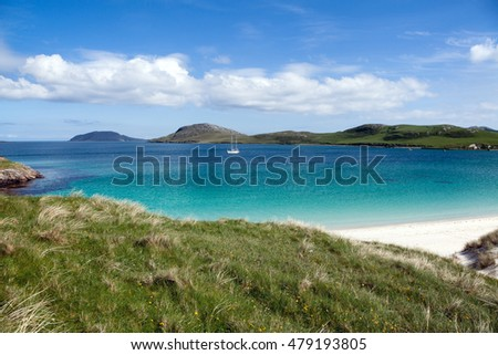 Summer scenery on the Isle of Vatersay, Scotland : white beach and colorful sea