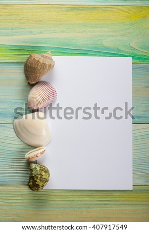 Summer sea vacation background. Notebook blank page with Travel items on blue green wooden table. Sea shells, pebbles, top view mockup - stock photo