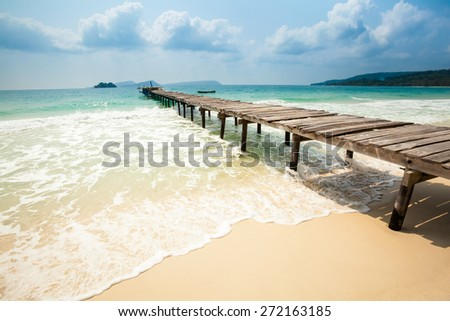 Summer seascape on tropical island Koh Rong in Cambodia. Landscape of south east Asia with wooden pier.