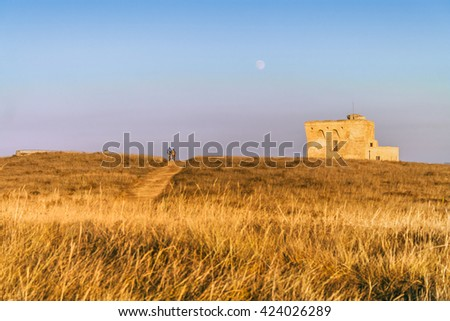 Summer seascape,Salento coast: Nature Reserve of Torre Guaceto.BRINDISI (Apulia)-ITALY-Mediterranean maquis: a nature sanctuary between the land and the sea. Nature trail: bike ride at the watchtower. - stock photo
