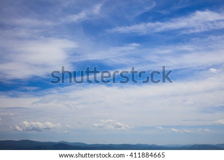 Summer skyscape over endless mountains - stock photo