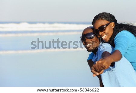 Summer smiles on an attractive black couple - stock photo