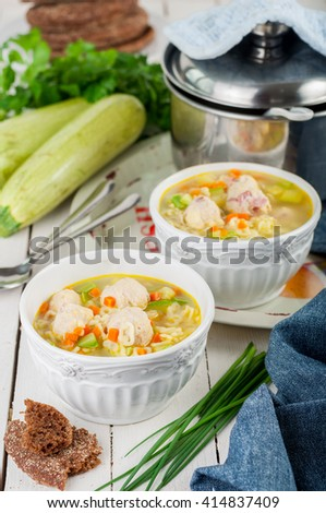 Summer Soup with Zucchini, Pasta and Chicken and Ham Meatballs - stock photo
