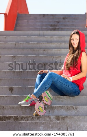 Summer sport and active lifestyle. Cool teenage girl skater with skateboard on the stairs. Outdoor.