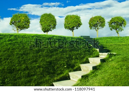 summer, stone ladder to the hill in the vivid park - stock photo
