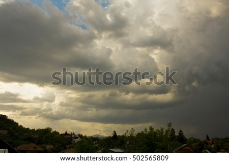 Summer storm comes over the town