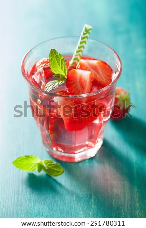 summer strawberry lemonade with lime and mint - stock photo