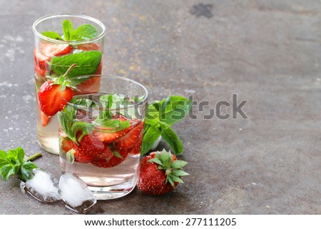 Summer strawberry lemonade with mint and ice - stock photo