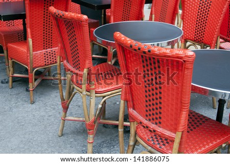 Summer street cafe with bright red chairs