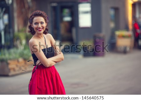Summer street portrait of a beautiful young Caucasian girl  - stock photo