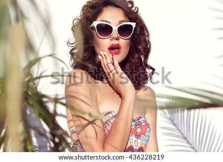 Summer style portrait of young attractive surprised woman wearing sunglasses. Tropical summer holiday fashion beauty  concept - stock photo