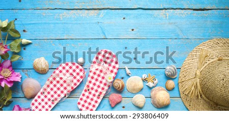 Summer sunbathing beach vacation concept, flip flops, seashells, good copy space - stock photo