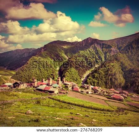 Summer sunny morning in the village Adishi. Upper Svaneti, Georgia, Europe. Retro style. - stock photo
