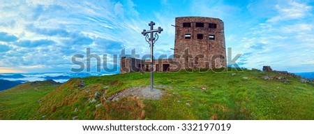 Summer sunrise observatory ruins panorama view on Pip Ivan mountain top with christianity cross near (Chornogora Ridge, Carpathian, Ukraine).