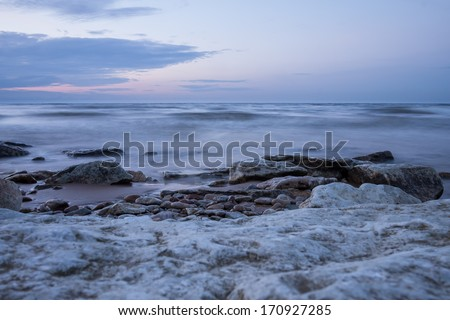 Summer Sunrise over a pebble beach in the north - stock photo