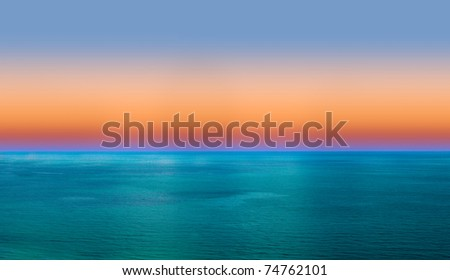 Summer sunrise over blue sea - stock photo