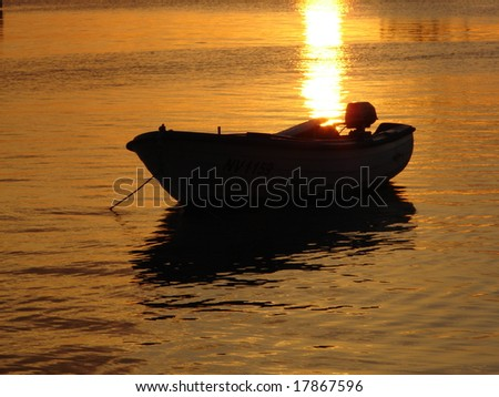 summer sunset on seat with boat