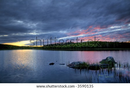 summer sunset over a calm northern river - stock photo