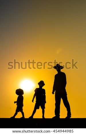 Summer sunset with happy family on outdoors background