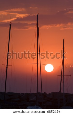 Summer sunset with mast silhouettes