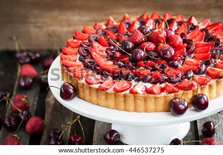 Summer tart with custard cream, fresh cherry and strawberry - stock photo