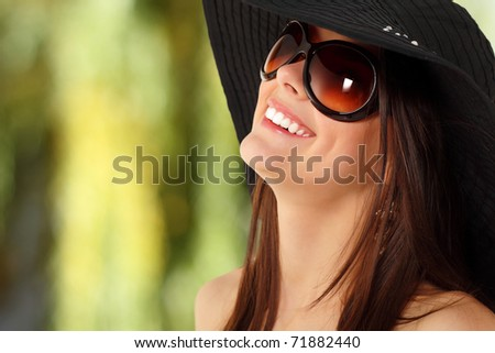 summer teen girl cheerful in panama and  sunglasses enjoying over nature background