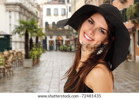 summer teen girl cheerful in panama and  sunglasses enjoying over Venice background