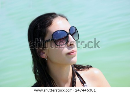 Summer teen girl cheerful in sunglasses