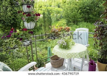 Summer Terrace or Balcony with small Table, Chair and Flowers - stock photo