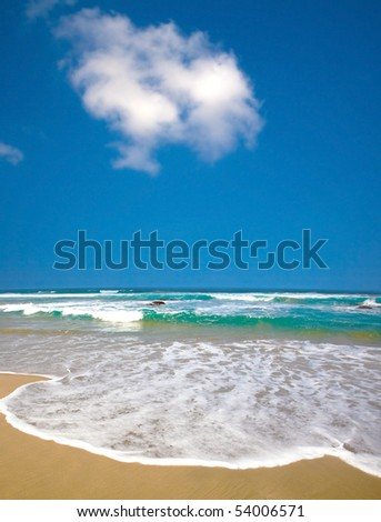 Summer time at the beach with clear sky - stock photo